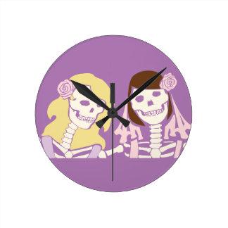 Blonde and Brunette Female Skeleton Couple Round Clock