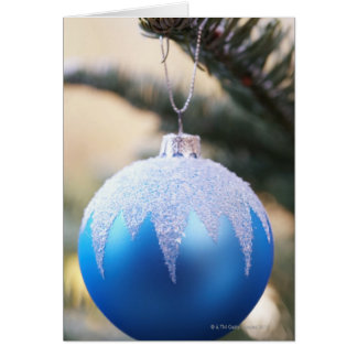 Blue bauble on Christmas tree, close up Greeting Card