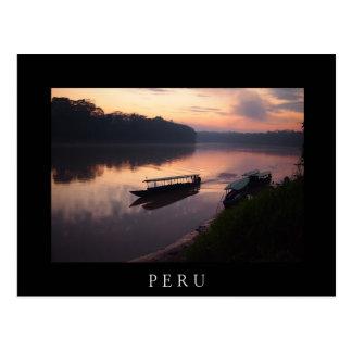Boat on river in Amazon rainforest black postcard