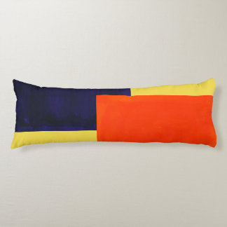 Body Pillow that is Orange, Purple, and Yellow.
