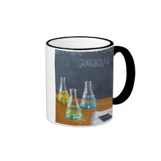 Bottles arranged for science experiment ringer mug