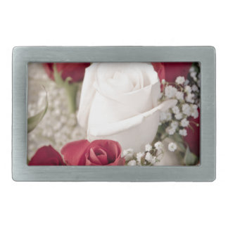 bouquet of red roses with one white rose in center rectangular belt buckle