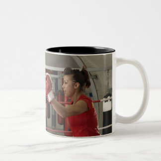 Boxer training with coach in gym Two-Tone coffee mug
