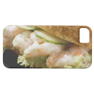 Bread roll filled with shrimps, cucumber and iPhone 5 covers