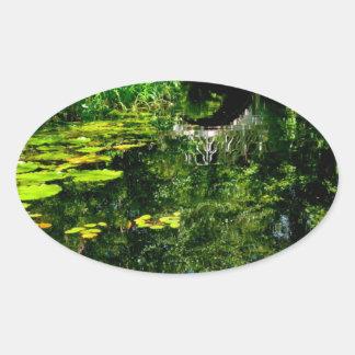 Bridge Over Peaceful Water Oval Sticker