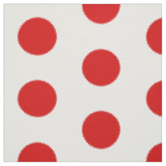 Bright red fluffy spots on white b/g fabric
