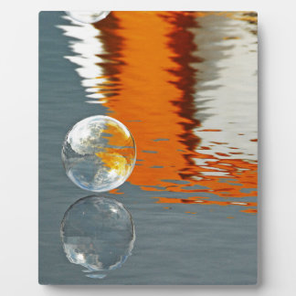 Bubbles Reflecting in Water Photo Plaques