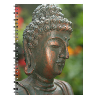 Buddha Statue With Flowers in Background Notebook