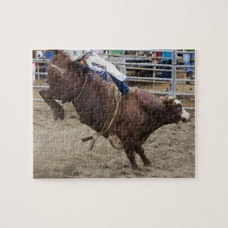 Bull rider at rodeo jigsaw puzzle