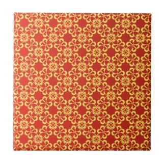 burnt orange and gold pattern tile