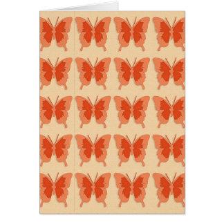 Butterflies, orange on a pastel orange background greeting card