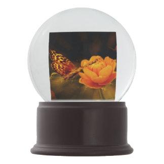 Butterfly Landing on Flower Snow Globes