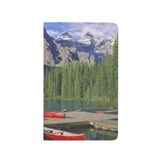 Canada, Alberta, Moraine Lake. Red canoes await Journal