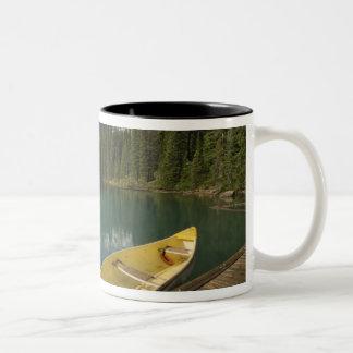 Canoe parked at a dock along Moraine Lake, Banff Two-Tone Coffee Mug