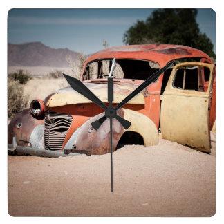 Car Skeleton in the desert Square Wall Clock