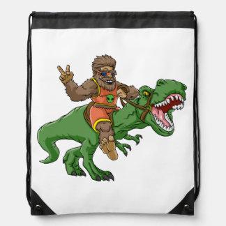 cartoon bigfoot-cartoon t rex-T rex bigfoot Drawstring Bag