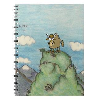 Cartoon yak drawing on mountain top notebook