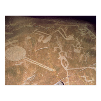 Carved petroglyph depicting figures postcard
