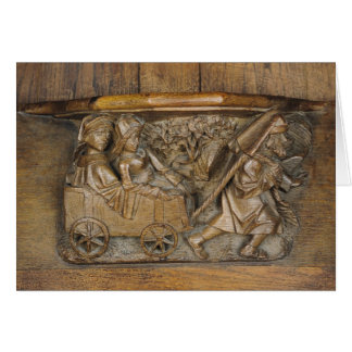 Carving depicting a couple in cart pulled by a card