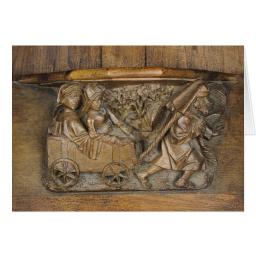 Carving depicting a couple in cart pulled by a cards