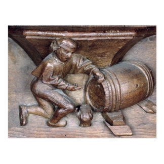Carving depicting a man putting a tap on barrel postcard