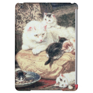 Cat with her Kittens on a Cushion