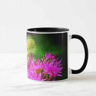 caterpillar and pink flowers mug
