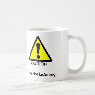 Caution I m Not Listening Coffee Mug