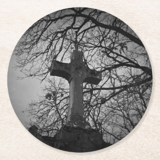 Cemetery grave cross sheltered by tree branches round paper coaster