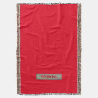 CHIC THROW_TAUPE TAG WITH MONOGRAM ON RED THROW BLANKET