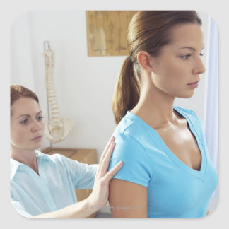 Chiropractic examination of the thoracic spine. square sticker