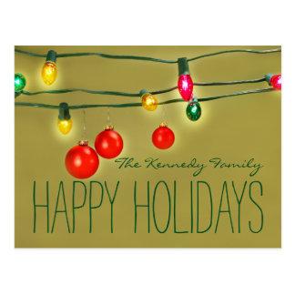 Christmas balls hanging on lights postcard