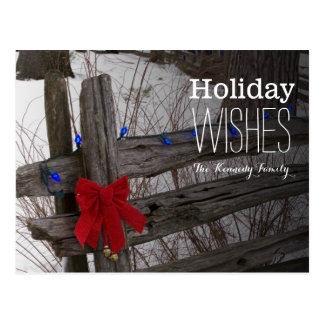 Christmas decorations on an old wooden fence postcard