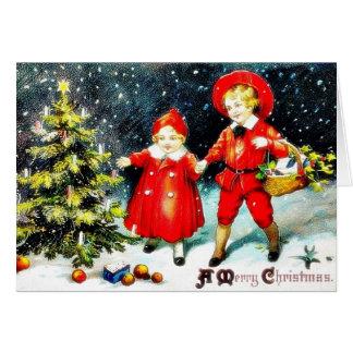 Christmas greeting envelope with garland around greeting card