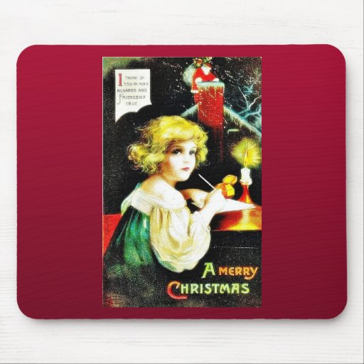 Christmas greeting with a girl writes something a mouse pad