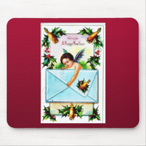 Christmas greeting with a kid like an angel holds mousepad