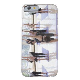 class practicing yoga with instructor in a barely there iPhone 6 case