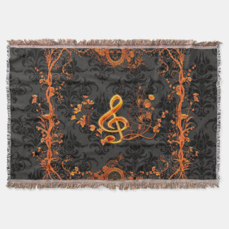 Clef on dark damask throw blanket