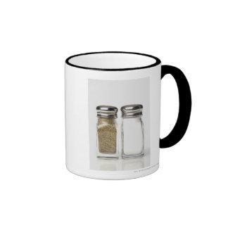 Close-up of a salt and a pepper shaker ringer mug