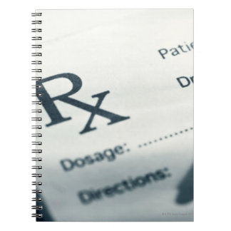 Close up of prescription pad and pen notebooks