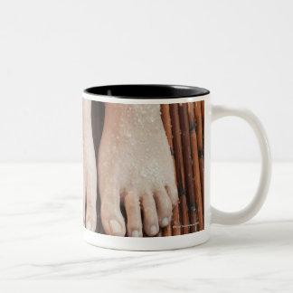 Close-up of womans feet having spa treatment mug