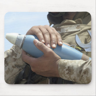 Close-up view of a soldier cradling a munition mouse pad