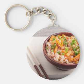 Closeup Asian dish of rice noodles and vegetable Basic Round Button Key Ring