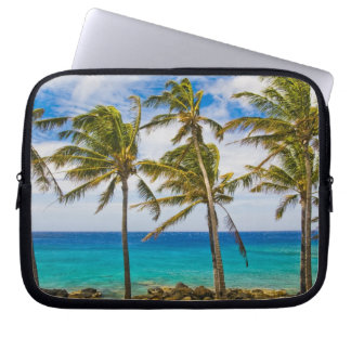 Coconut palm trees (Cocos nucifera) swaying in Laptop Sleeve