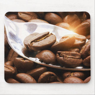 Coffee beans close up on a spoon with sunlight ref mouse pad