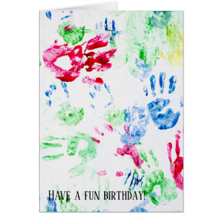 colorful child handprint on white card