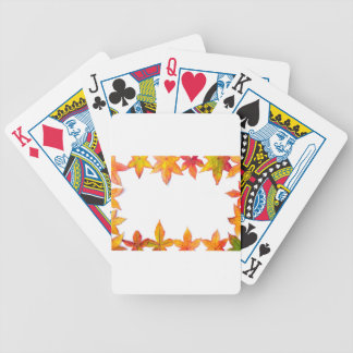 Colorful fall leaves framework on white bicycle playing cards
