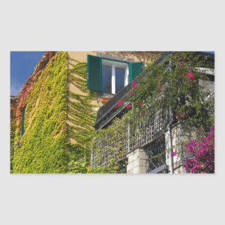 Colorful leaves on house rectangular sticker