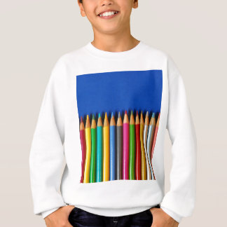 Colorful pencil crayons on blue background tees