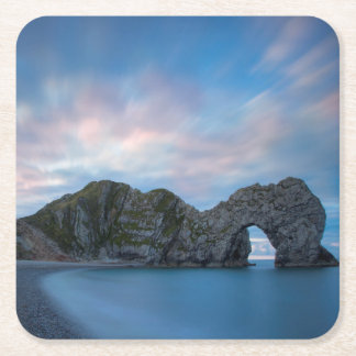 Colorful sky at dawn over Durdle Door Square Paper Coaster
